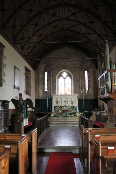 The aisle with pews either side and looking towards the altar