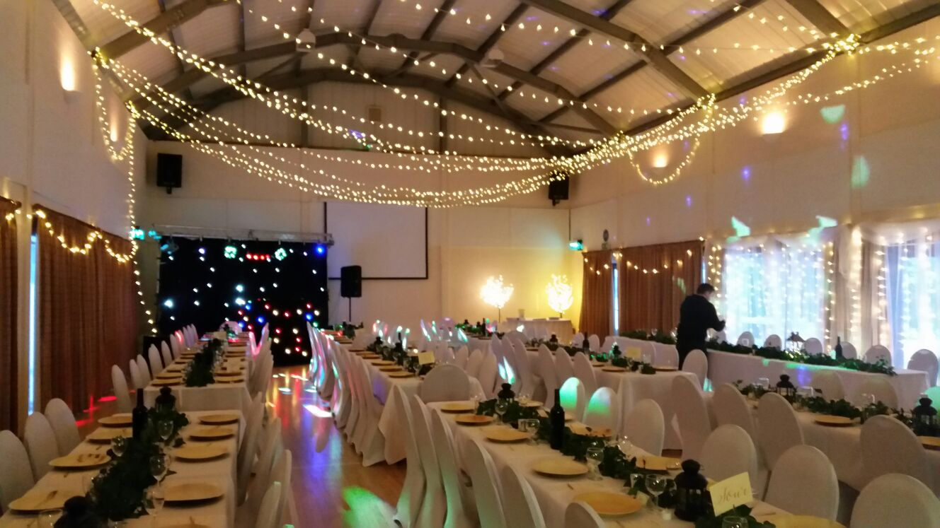 Millennium Hall set out with tables and chairs for a wedding