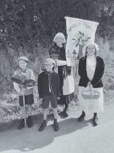 Black and white photo of children with banner