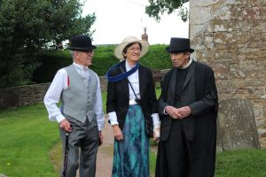 Two men and a woman in victorian costumes