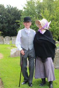 Man and woman in victorian costumes