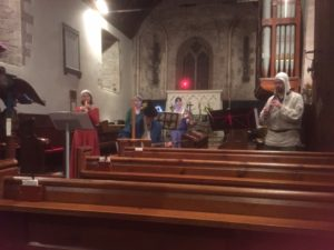 People in fancy dress playing instruments in the church