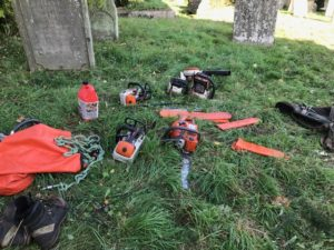 Workmen's tools lying among gravestones