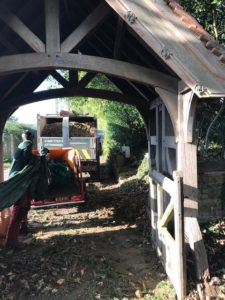 Wood chips being put into a lorry by the lytch gate