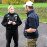 A poilce officer talking to a man