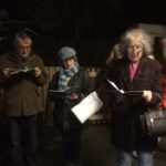 Carol singers at night