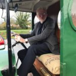 The vicar in a vintage car