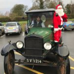 Father Christmas in an old green car