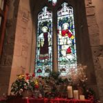 Flowers and a stained glass window