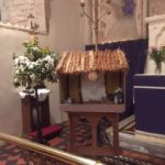 A model crib and flowers