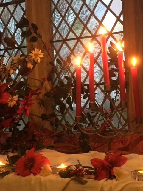 Candles and flowers on a window sill