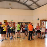 Hall full of people in running gear