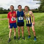 Three men in running gear