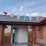 Brick house with bunting