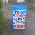 Blue sign saying thank you heroes past and present