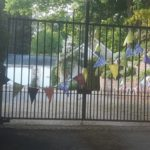 Metal gate with coloured bunting