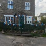 House decorated with red, white and blue bunting