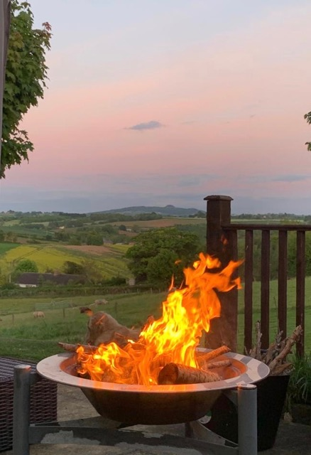 View of May Hill with a fire pit in the foreground