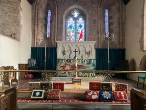 Newly stitched kneelers in front of the altar in the church
