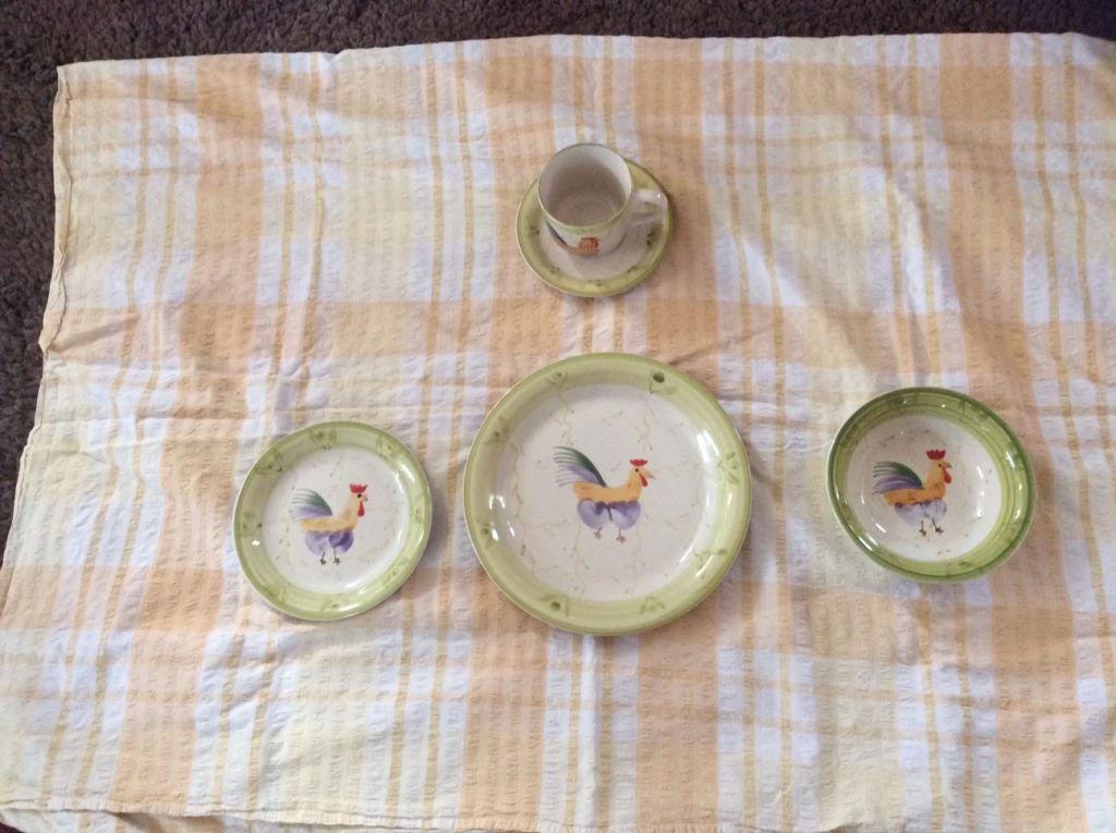 Plate, bowl, cup and saucer decorated with a cockerel