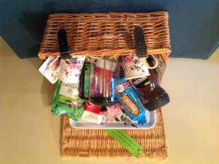 Wicker basket with coffee, biscuits and a caffetiere