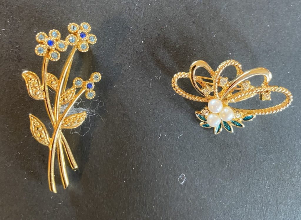 Two small brooches
