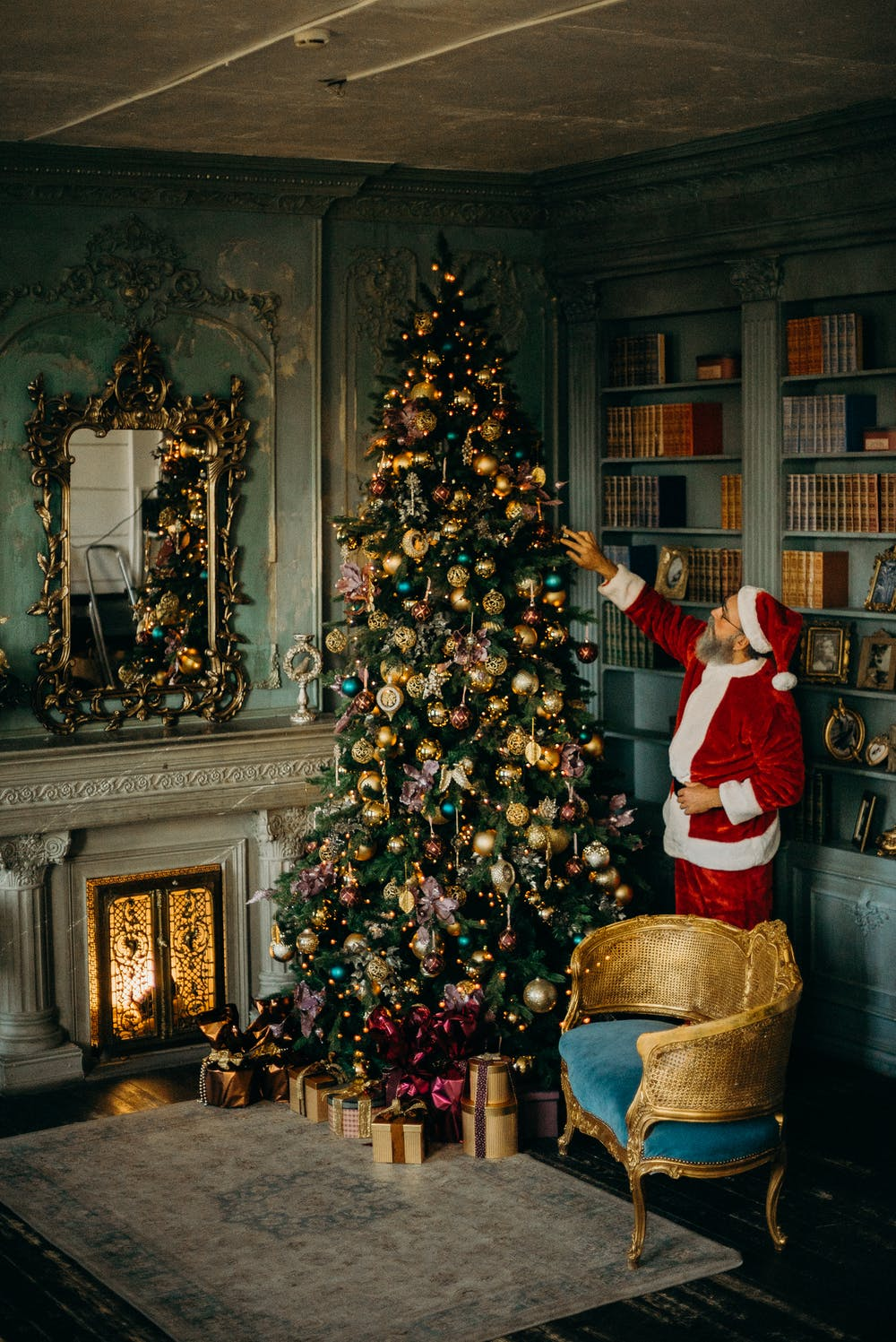 A Christmas tree and a man dressed as Father Christmas
